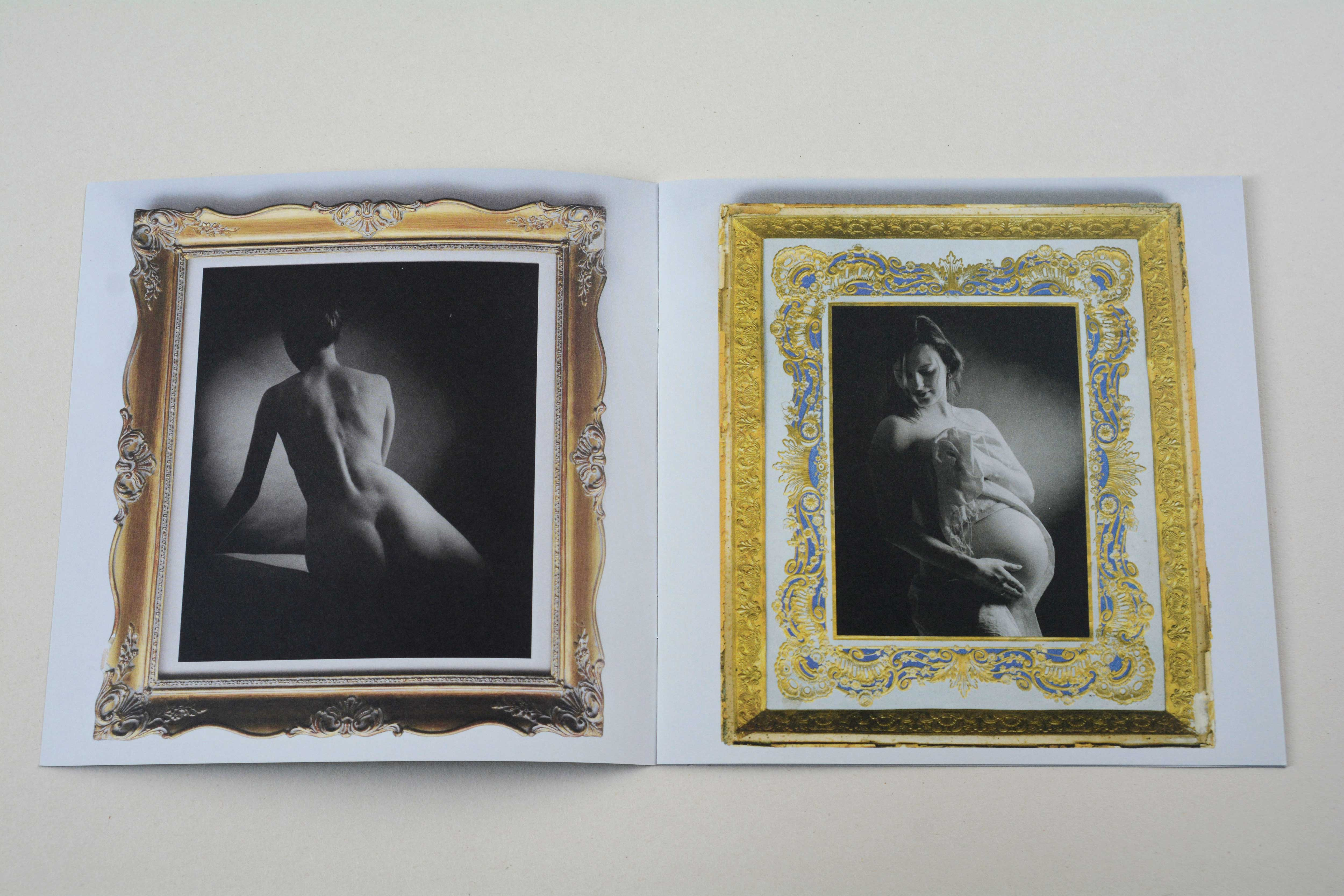 Double page. Opulent golden frame with b/w photo on each page.