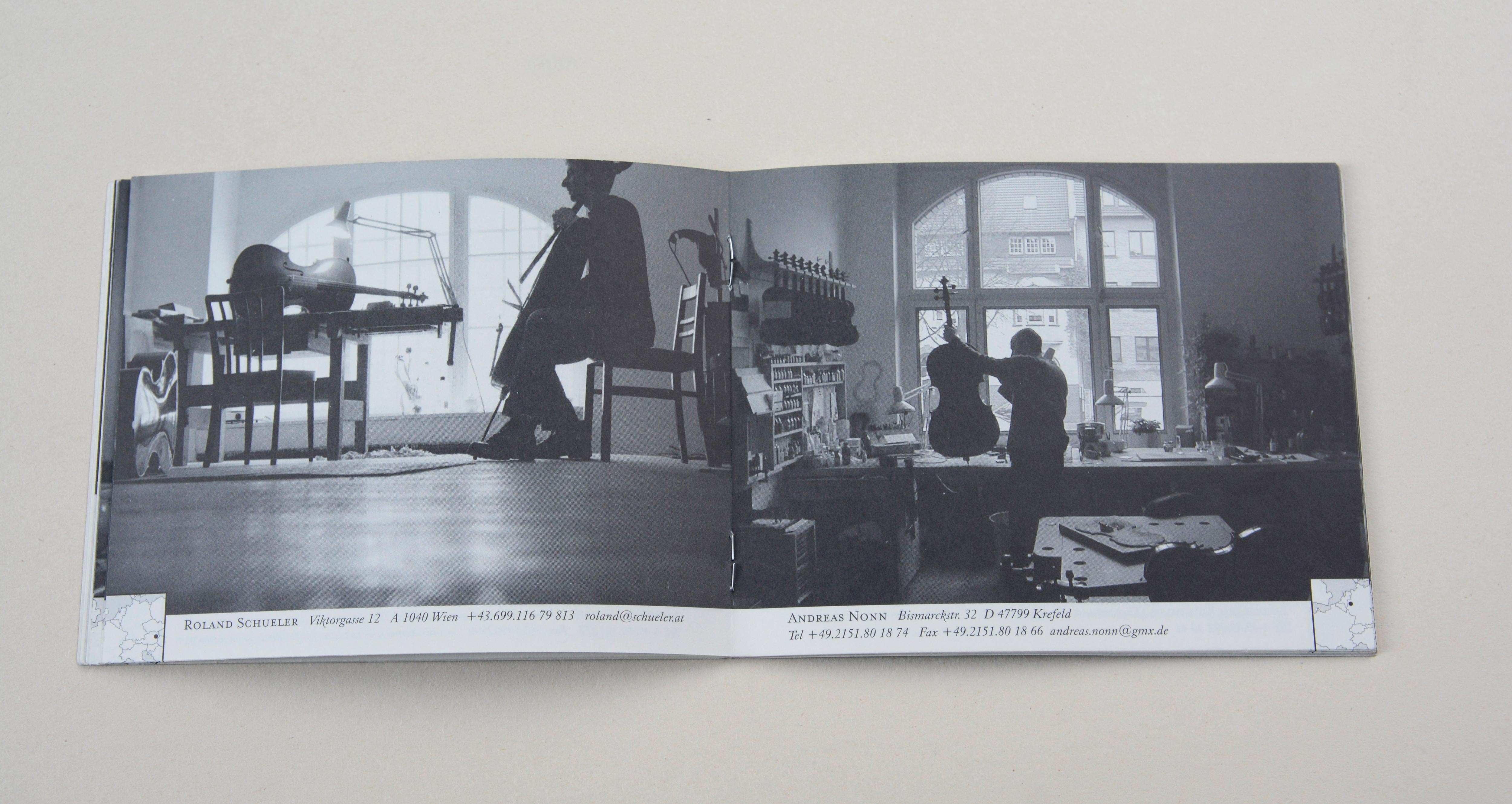 Double page. On each page full-page b/w photos. Thumbnail sized map with marking point at bottom corner. Line of small text in white space underneath. Left: Man sitting in a workshop. He plays a chello. Right: Man standing in a workshop in front of workbench. He holds chello in his hand.
