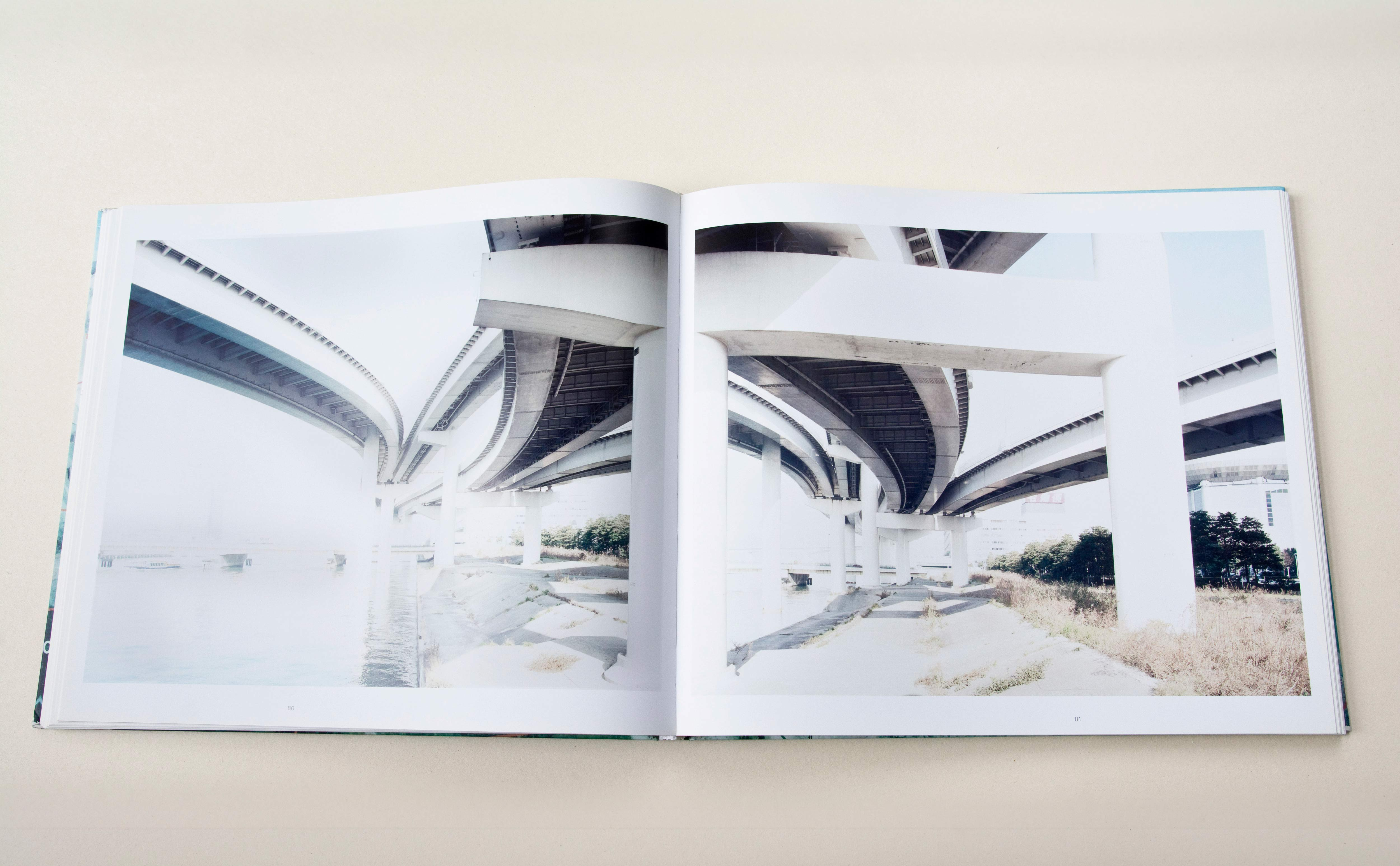 Double page. Large photo with white space around on each page. Left: Under the bridegs of highway junction beside river. Right: Shot from different angle at same location.
